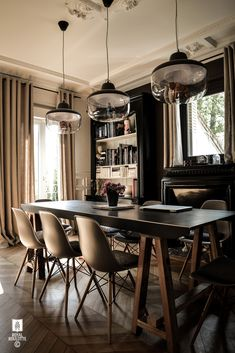 Dining room with ceiling detail, Eames chairs, 3 pendant lights with figures from David Weeks, custom trestle table