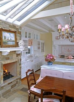 Kitchen, Fireplace And Dining Table