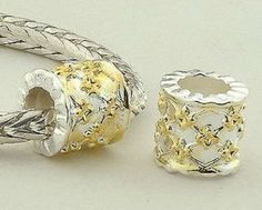 """18k Gold on 925 Sterling Silver """"Web"""" Charm Beads for Pandora, Biagi, Chamilia, Troll and More Bracelets general gifts. $13.99. Suitable for 3mm Cable Pandora and other European Charm Bracelets. Weight: 1.8 gram  Hole Size: 4.5mm. Color: Silver with 18K gold. 18K gold plated 925 Sterling Silver. Quantity: 1pc. Save 72% Off!"""