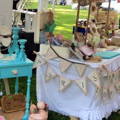 Craft booth display- love the ruffles,bunting and turquoise table