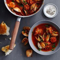 Cataplana Stew with Sausage and Clams | Portuguese cataplana is a long-simmered pork stew to which clams are added. For our quick take on the dish, we've replaced the usual pork shoulder with sausage.