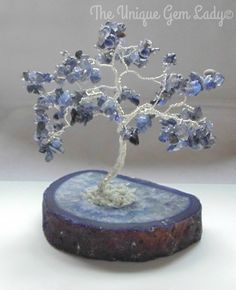 Check out this item in my Etsy shop https://www.etsy.com/uk/listing/268122608/iolite-gemstone-tree-wire-wrapped