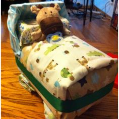 Bassinet diaper cake...decided to wrap the package of diapers this time! :)