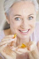 Taking Calcium and Vitamin D Lowers Risk of Hip Fractures: Taking calcium supplements along with modest amounts of vitamin D can substantially reduce the risk of hip fractures in postmenopausal women.