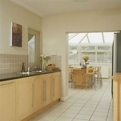 [Modern Galley Kitchen Conservatory Diner Dining Room Furniture Easy Way Improve Old Update Lighting Drawer] galley kitchen kitchens the best Narrow Kitchen Extension, Long Narrow Kitchen, Long Kitchen, Kitchen Layout, New Kitchen, Kitchen Design, Kitchen Ideas, L Shaped Kitchen, Kitchen Remodel