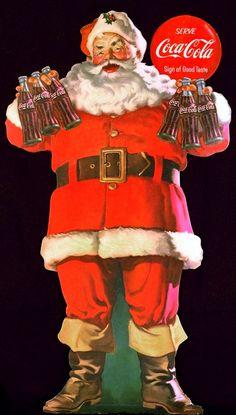 Santa holding bottles of Coke...
