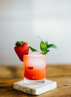 Mint and a strawberry: http://www.stylemepretty.com/living/2015/06/18/19-easy-garnishes-to-dress-up-your-drinks/