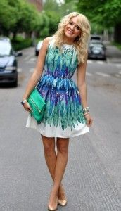 Green and white patterned summer dress with nude heels and green clutch