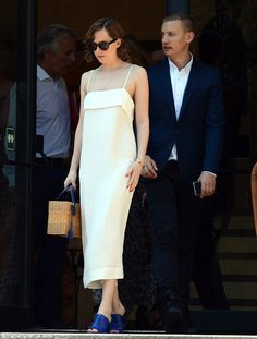Elegant: Dakota Johnson, 25, was spotted wearing a chic white gown in Barcelona on Tuesday