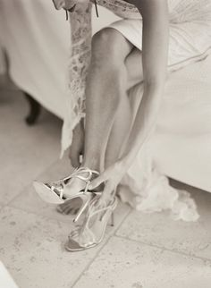 Pin for Later: 41 Smart Ideas For Gorgeous Wedding Detail Shots 15. Bride Putting On Shoes