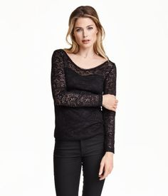 Fitted top in sheer lace with a V-neck at front and back and long sleeves. Partly lined in jersey.