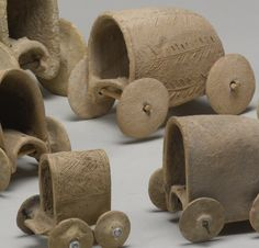 Syrian Terracotta 'Conestoga' Covered Wagons, c. 2000-1600 BC These simple ceramic vehicles reflect the distinctive moment when men first used domesticated animals to draw wheeled vehicles, thus beginning powered transport on land. Probably drawn by...