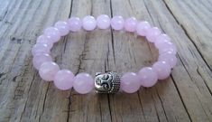 Pink rose quartz bracelet with Buddha head bead  genuine rose