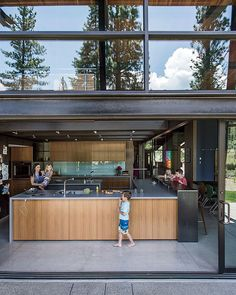 A forest sanctuary designed to support autistic triplets, their parents, and a host of caregivers.