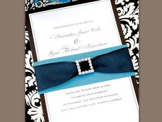 Create an invitation that plays on your personality. Use a black border invite with ribbon in your color palette to add a royal touch to your special day.