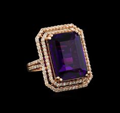 """One electronically tested 14KT rose gold Ladies combination cast & assembled ring with a bright polish finish. Condition is new. Identified with markings of """"K14"""". Containing: One prong set emerald standard step cut natural amethyst, measuring 17.96 x 13.10 x 8.50mm, approximate weight of 14.36ct., clarity is eye clean, type II, medium dark, moderately strong, purple color, (GIA P 6/4), cut is very good. Colored gemstones are presumed to have been subjected to commonly used..."""