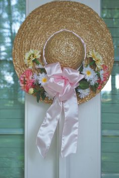 Garden Hat Tutorial -  Here is an alternative to the traditional wreath that is perfect for any garden theme room, a front door, or porch. Hang a garden hat on your door, wall, or the back of a chair or lay it on a bench or table for the perfect cottage garden look! Spring wreath..