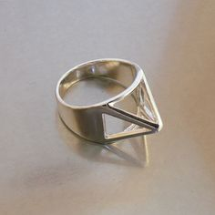 I totally dig this pyramid ring. Click for purchase info.