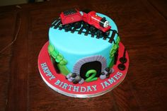 James. Thomas's train friend. - My friend wanted me to make a Thomas the tank engine cake but with the train james. She supplied the train and i did the rest, learnt some awesome new techniques for this one. Inspired by another Thomas cake on CC.