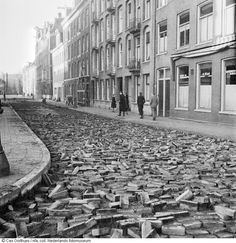 1944 - 1945. View of a broken up street in Amsterdam during the Hunger Winter. During the Winter of 1944-1945 Dutch rail workers went on strike to stop the Germans, who then punished them by putting a hold on all maritime transport. This cut off all food and fuel delivery. More than 20,000 people lost their lives in Amsterdam and the western part of the Netherlands during the winter of 1944-1945. #amsterdam #wordwar2 #hongerwinter