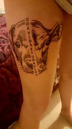 Vegan thigh dot work tattoo. 'A Life is a Life'. Half cow, half dog.