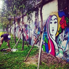 Zoe Latham graffiti piece in Shenzhen.. inspired by Alfonse Mucha