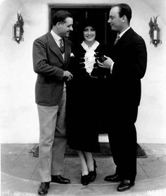 André Luguet introduces Joan Crawford to Baron Philippe de Rothschild, a visitor do the M-G-M studios Tags: 1930