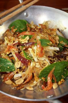 "Vietnamese Banh Trang Tron (Rice Paper Salad)  Housemade Pepper/Sweet Beef Jerky (Thịt bò khô), Crispy Shrimp, Roasted Squid, Fried Shallot, Napa Cabbage, Green Papaya, Peanuts, Mint, Basil, Rice Paper ""Noodles"" & Chili/Lime Dressing"