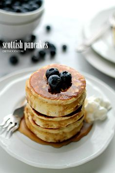 Scottish Pancake- Sweet, fluffy, delicious pancakes served with honey and berries.