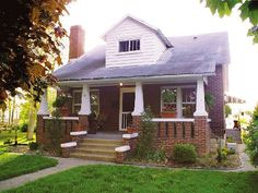 Brick Built Craftsman House With Sitting Porch And White Accents