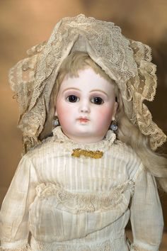 Circa 1885 15 ( 38 cm ) classic so-called  Portrait  Jumeau with pale pressed bisque socket head incised  5 , with amber paperweight eyes in almond