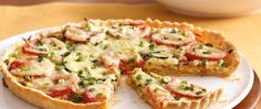 Rolled refrigerated pie crust is the base for a pretty, pleasing pizza showcasing sweet onions, tomatoes and cheese.