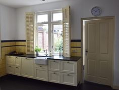 Our new house: the kitchen - Anne Travel Foodie Green Kitchen, New Kitchen, Small Stove, Yellow Tile, Wooden Shutters, Kitchen Stories, Cabinet Space, Foodie Travel, White Walls