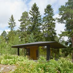 This small woodland house on theStockholm archipelago designed by Swedish studioKrupinski/Krupinska Arkitekter features a dark wooden core encased in glass and topped by a broad roof. Summer House T replaces an existing summer house located in the grounds of a property owned by a couple with two daughters. Stockhom-basedKrupinski/Krupinska Arkitekter designedtheresidencefor one of the daughters,