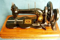 Bradbury No.1.   This machine was sold through Bradbury's Cardiff agent Henry Thomas, not only is the machine badged for him but it came with it's original manual and a receipt dated 31st July 1891.