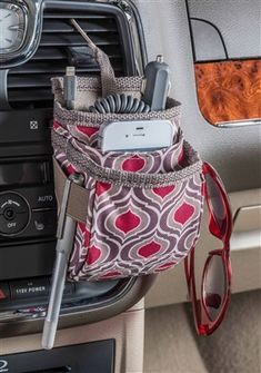 An air vent cell phone organizer with extra storage for charging cords pens, sunglasses and more. The High Road DriverPockets is now available in our exclusive Sahara pattern. See more of the Sahara car organizer collection at www.highroadorganizers.com