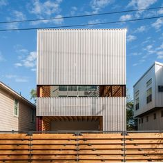 Taking influences from the vernacular houses of the southern US, this low-cost house in Houston by ZDES architects is designed to accommodate a family, but can be divided up to allow the owners to rent out private areas.