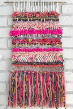 Isn't this tapestry gorgeous?! It is made with two of our Wildflower yarns (Goldenrod and Coral Crush)! Boho tapestry weaving, boho knits, weaving ideas,