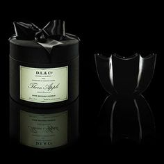 D.L. & Co Thorn Apple Candle - Patented blend of soy, maple and palm waxes that diffuse in signature scallop glass bowl. Hand wrapped in perfectly pleated tissue and packaged in signature black silk hat box with satin ribbon. 10 oz.