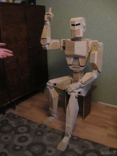 Wooden Cylon made by Ukranian Battlestar Galactica fan Dmitry Balandin, made over a period of six months with 500 pieces of plywood.