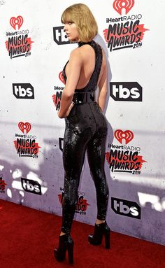 Taylor Swift: Skintight  the 26-year-old singer wore a figure-hugging sequinned catsuit (Saint Laurent)  from Autumn/Winter 2016 collection collection | iHeartRadio AwardsThe Forum Los Angeles April 2016