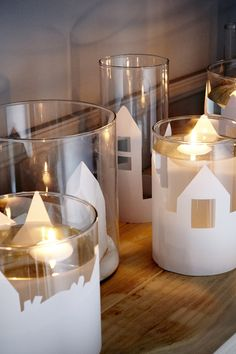Create a seasonal landscape on your table with IKEA decorative vases and floating candles!  The warm hues and soft glow of the candle get any room in your home ready for the fall.
