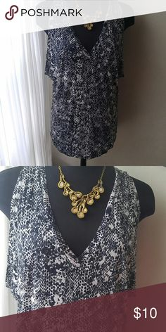 Sassy little tank New, never worn. Super cute deep v-neck.. Be aware it has deep arm holes( gives a little.peekaboo action on the sides) Ya gonna need a cami or double sided tape with this cutie. 100% rayon. Get noticed in this. Ana Tops