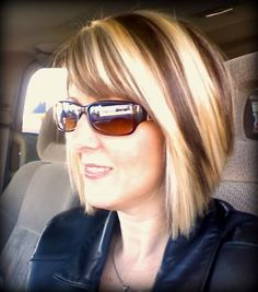 Chunky Blonde Highlights ..like the blonde  color of the blonde(bright) and the color of the brown ..just narrower strips of the highlight