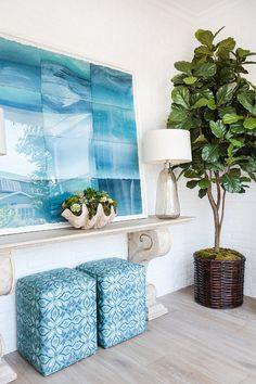 I love this artwork which works so well in this California Beach House with its pale grey wood floors and white walls