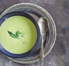 Broccoli Cheese Soup  1 cup (240 ml) skim or low fat milk 1/2 cup (38 g) shredded low fat cheddar cheese 1 1/2 cups (195 g) broccoli or cauliflower, fresh or frozen, steamed 1 teaspoon diced onion 1/2 chicken or vegetable bouillon cube