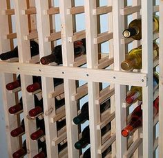 DIY wine rack. Looks a little like the ones at World Market. Simple and utilitarian. I'd probably paint it or put the assembly in a cabinet.