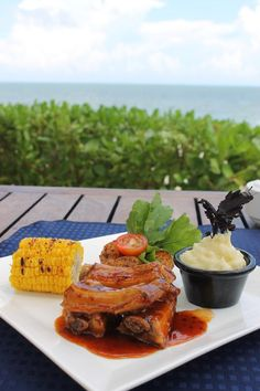 Classic southern bbq served with a striking beach view at Secrets Capri Riviera Cancun. These saucy ribs taste just as good as they look!
