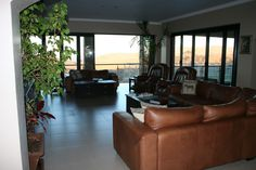 Large lounge with stacking doors to balcony and patio - fab views Barbeque Pizza, Stacking Doors, Solid Wood Kitchens, Granite Tops, Electric Oven, Wood Bars, Kitchenette, Open Plan, Balcony