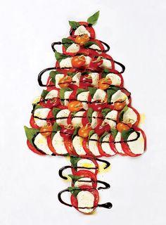 Caprese Christmas Tree Large platter & knotted bamboo toothpicks De Nigris Balsamic Glaze, EVOO, Fresh basil, multicolored tomatoes, fresh bocconcini, ground black pepper and sea salt